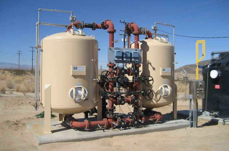 The arsenic removal system consists of two 5-ft-diameter adsorption vessels in parallel, tanks A and B, each containing 69 cubic feet of granular ferric oxide pelletized media.